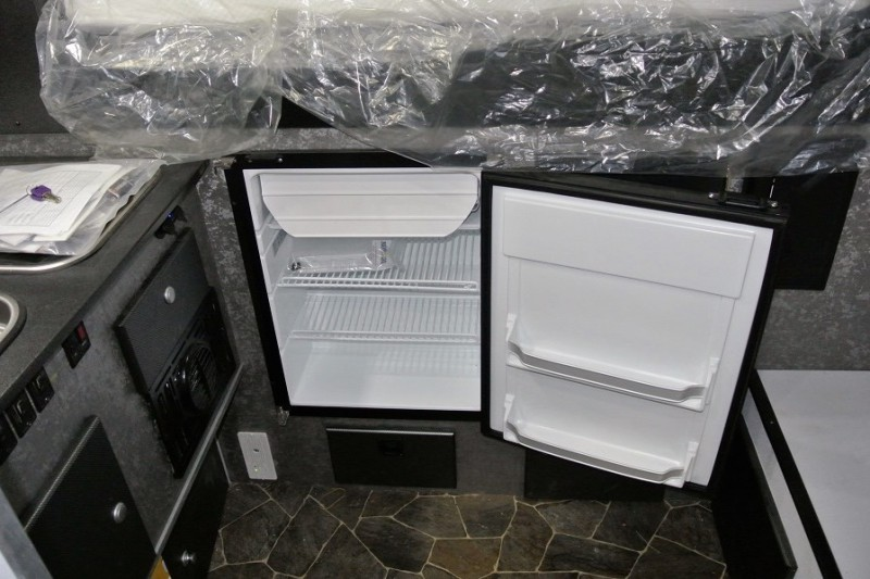 Fridge-located-along-front-wall-of-camper